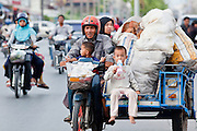 """Sept. 24, 2009 -- PATTANI, THAILAND:  Muslim families on motorized trishaws in Pattani, Thailand. Thailand's three southern most provinces; Yala, Pattani and Narathiwat are often called """"restive"""" and a decades long Muslim insurgency has gained traction recently. Nearly 4,000 people have been killed since 2004. The three southern provinces are under emergency control and there are more than 60,000 Thai military, police and paramilitary militia forces trying to keep the peace battling insurgents who favor car bombs and assassination.   Photo by Jack Kurtz / ZUMA Press"""