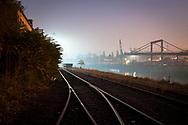 tracks and crane at night in the Rhine harbor in the district Deutz, Cologne, Germany.<br /> <br /> Schienen und Verladekran nachts im Deutzer Hafen, Koeln, Deutschland.