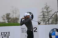 Emiliano Grillo (ARG) tees off the 2nd tee during Saturay's Round 3 of the 2014 BMW Masters held at Lake Malaren, Shanghai, China. 1st November 2014.<br /> Picture: Eoin Clarke www.golffile.ie