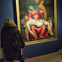 "VENICE, ITALY - NOVEMBER 23: A woman admires the ""Pieta'"" by Lorenzo Lotto at the press preview of Tribute to Lorenzo Lotto - The Hermitage Paintings at Accademia Gallery on November 23, 2011 in Venice, Italy. The exhibition which includes two very rare & never seen before paintings opens from the 24th November 2011 to 26th February 2012 in Italy."
