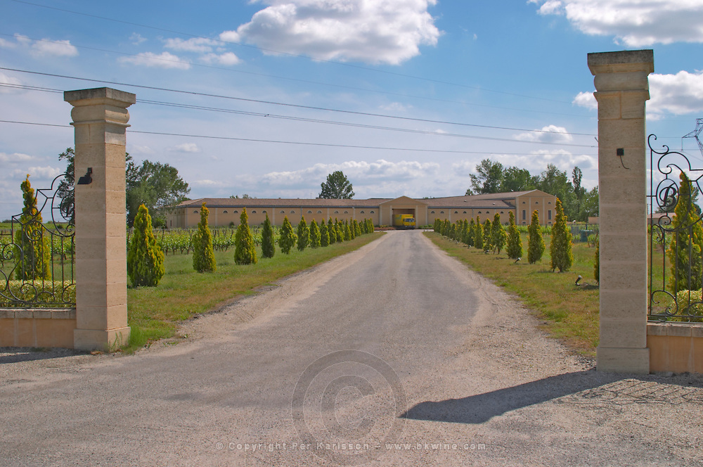 The back entrance to the Chateau Haut Bertinerie with gate posts and a tree lined road leading up to the winery  Cotes de Bourg  Bordeaux Gironde Aquitaine France