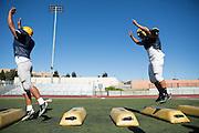 Milpitas High varsity football team runs through drills to prepare for Friday's game against Woodside (away) at Milpitas High School in Milpitas, Calif., on Aug. 28, 2012.  Photo by Stan Olszewski/SOSKIphoto.