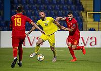 PODGORICA, MONTENEGRO - JUNE 07: Vedat Muriqi of Kosovo and Igor Vujacic of Montenegro during the 2020 UEFA European Championships group A qualifying match between Montenegro and Kosovo at Podgorica City Stadium on June 7, 2019 in Podgorica, Montenegro MB Media