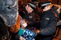 © licensed to London News Pictures. London, UK. 30/01/12. Police and protestors argue for control of tents. Bailiffs & police move to evict the 'Bank of Ideas' squatted UBS property on sun street and adjacent squat on Earl Street, EC2 after UBS obtained a possession order for the property. Photo credit: Jules Mattsson/LNP