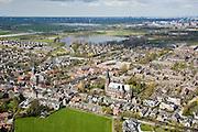 Nederland, Noord-Holland, Abcoude, 16-04-2008; dorpskern met twee kerken; links PKN (protestantse kerken nederland ) en rechts RK.(rooms katholiek); de plas achter het dorp is het Abcouder meer, rechts daarvan aan de horizon Bullewijk / AMC;  .kerkgebouw, geloof, villadorp, yup, yuppie, ..luchtfoto (toeslag); aerial photo (additional fee required); .foto Siebe Swart / photo Siebe Swart.