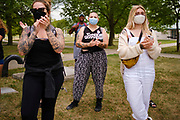 05 AUGUST 2020 - DES MOINES, IOWA: Members of Black Lives Matter socially distance and wear masks during a celebration of the restoration of felons' voting rights. Black Lives Matter had a press conference in central Des Moines Wednesday to comment on the executive order issued by Iowa Governor Kim Reynolds earlier Wednesday that restored voting rights felons who have completed their sentence and probation or parole. BLM has been protesting in Des Moines and meeting with the governor since early June in their effort to restore felons' voting rights. Until today, Iowa was the only state in the US that permanently stripped felons of their voting rights.      PHOTO BY JACK KURTZ
