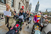 Arriving in Parliament Square for speeches - The March of the Mummies organised by Pregnant then Screwed to highlight discrimination in the workplace against women who have children.