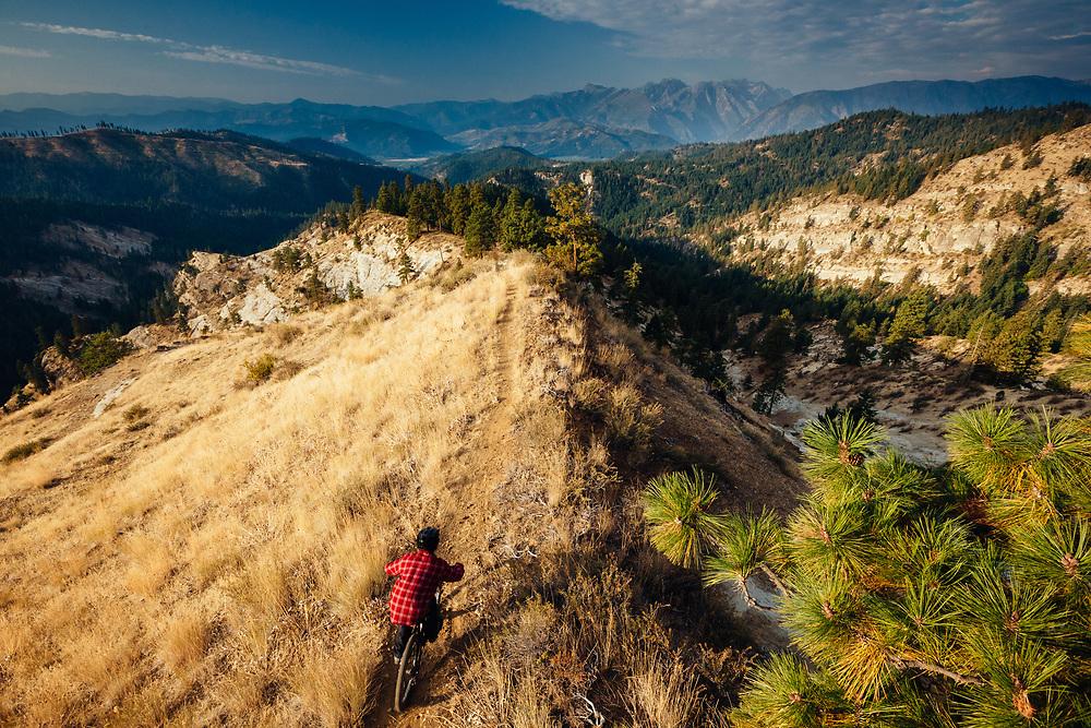 Rex Flake rides a ridgeline just after sunrise near Leavenworth, Washington.