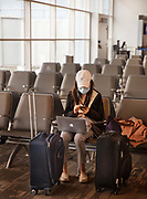 Masked lone traveller waiting for a plane in a deserted airport lounge on 10th March 2020 in New Orleans, United States. There has been a huge decline in people flying throughout the globe fueled by fears of the conovirus outbreak. An industry trade group said the coronavirus could wipe out between $63 billion and $113 billion in worldwide airline revenues.