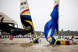 """Peter Gilmour and Sebastien Col during the finish on the last race of their quarter final. Gilmours spinnaker is flogging but passes the line first. The race officer saw it different and had Col winning the match. According to the empire call Gilmours spinnaker was in its """"normal"""" position during the finish which gives him the win over Col. Gilmour beats Col 3-2. The photo was taken form the start boat. (Saturday the 6th December 2008)."""
