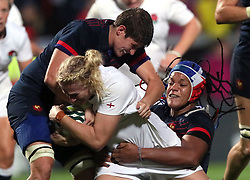 England Women's Alex Matthews is tackled by France Women's Audrey Forlani (left) and Safi N'Diaye during the 2017 Women's World Cup, Semi Final match at the Kingspan Stadium, Belfast.