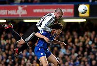 Photo: Ed Godden.<br /> Chelsea v Newcastle United. The FA Cup. 22/03/2006.<br /> Newcastle's Stephen Carr clambers over Joe Cole.