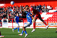 Portsmouth forward Jamal Lowe (10) is beaten by Accrington Stanley defender Michael Ihiekwe (4), on loan from Rotherham United,  in the air during the EFL Sky Bet League 1 match between Accrington Stanley and Portsmouth at the Fraser Eagle Stadium, Accrington, England on 27 October 2018.