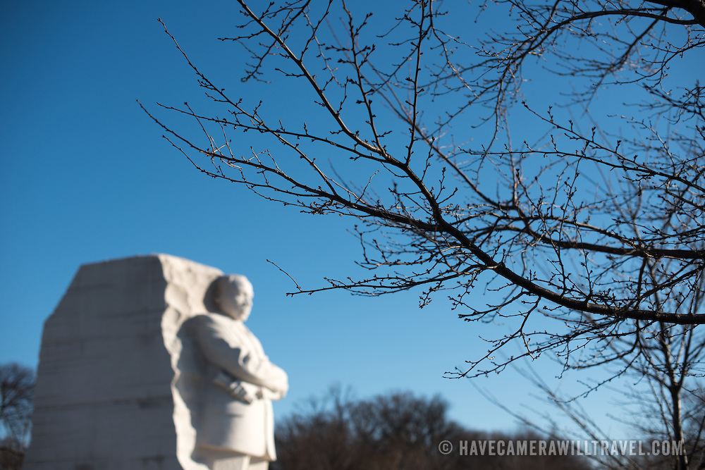 Opened in 2011, the Martin Luther King, Jr. Memorial commemorates the Civil Rights leader and the Civil Rights movement. It stands on the banks of the Tidal Basin in Washington DC. Its centerpiece is a large statue of Dr. King that was carved by Lei Yixin. In the foreground is a pre-flowering branch of the famous Yoshino cherry blossom trees that line the Tidal Basin.