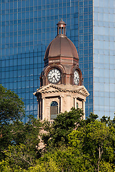 Tarrant County Courthouse in front of Wells Fargo Tower as seen from kayak on the Trinity River, Fort Worth, Texas, USA.