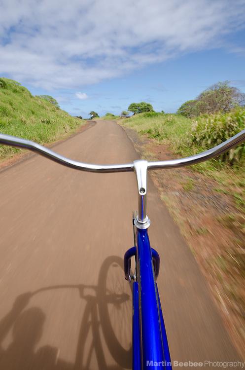 Bicycling along a bike path in Kapa'a, Kauai, Hawaii