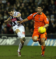 Photo: Rich Eaton.<br /> <br /> West Bromwich Albion v Luton Town. Coca Cola Championship. 12/01/2007. Jason Koumas tries a shot for West Brom tackled by Steve Robinson right of Luton