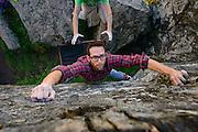 "Rock climber Dean Flemming climbs a boulder problem called ""Potatoe Chip"" V5, at Sunset Rocks in Sonoma Coast State Park, Jenner, California."