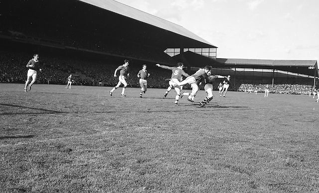 Players tackle during the All Ireland Senior Gaelic Football Final Cork v. Meath in Croke Park on the 24th September 1967.<br /> Meath 1-9 Cork 0-9.