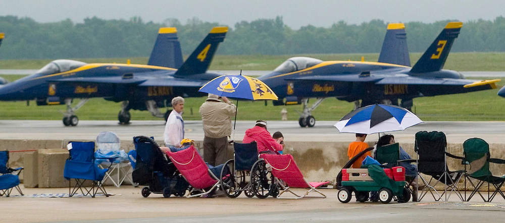 (PSUNDAY) McGuire AFB 6/4/2004  The Blue Angels lay silents on the flight line after weather forced the delay of in air performances.    EDS:  Due to weather the in air performances were either cancelled or delayed indefinitely until the conditions made it safe to fly. Please also note the crowds were VERY thin.  I did the best I could.   Michael J. Treola Staff Photographer....MJT