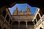 The towers of the Jesuit church and seminary of La Clerecia from the courtyard of Casa de las Conchas, Salamanca, Castilla y Leon, Spain.