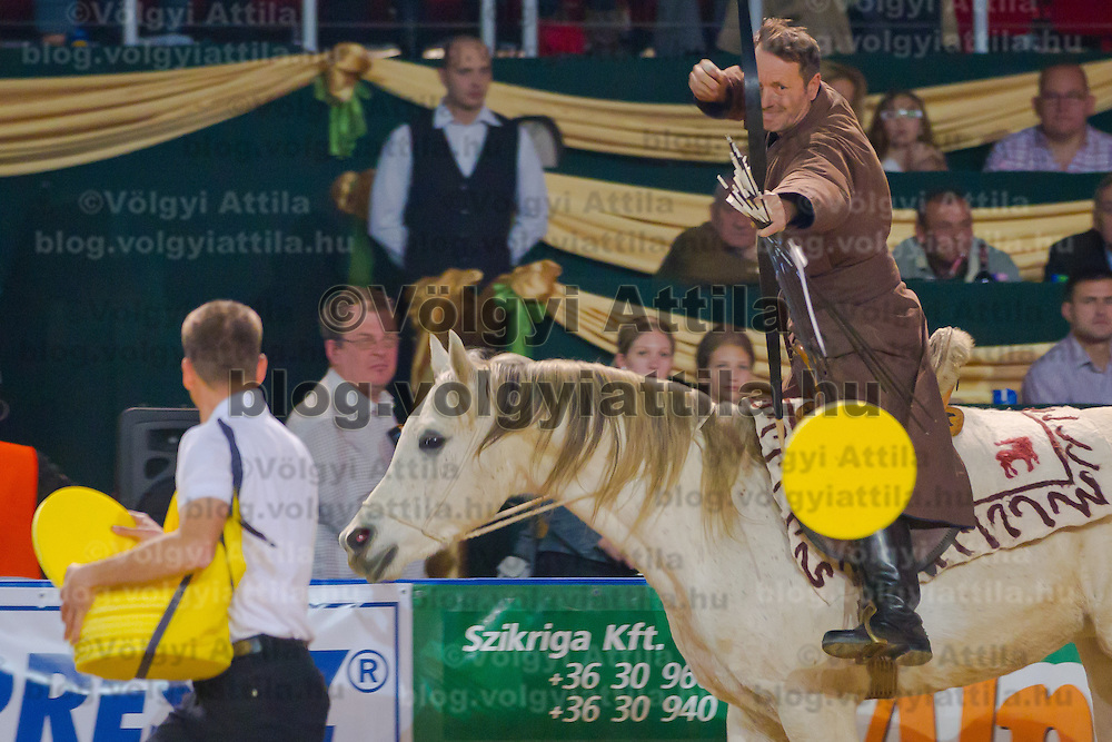Lajos Kassai follower of the traditional Hungarian horse mounted archery breaks his former Guinness World Record hitting 14 disks in 20 seconds during the OTP Bank Budapest Grand Prix Horse World Cup in Budapest, Hungary on December 04, 2011. ATTILA VOLGYI