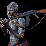 Bonko belongs to the Karo people of the Omo River Valley in Southern Ethiopia, who distinguish themselves by decorating their bodies with coloured ochre, white chalk, yellow mineral rock, charcoal and pulverized iron ore. On special occasions, Karo men spread ashes mixed with fat on their skin, a symbol of virility. The Kalashnikov he brandishes is deployed when people try to steal his cattle or encroach his land. (Canon MK IV)