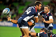 Victor Vito (HUR) blindly offloads<br /> Melbourne Rebels v The Hurricanes<br /> Rugby Union - 2011 Super Rugby<br /> AAMI Park, Melbourne VIC Australia<br /> Friday, 25 March 2011<br /> © Sport the library / Jeff Crow