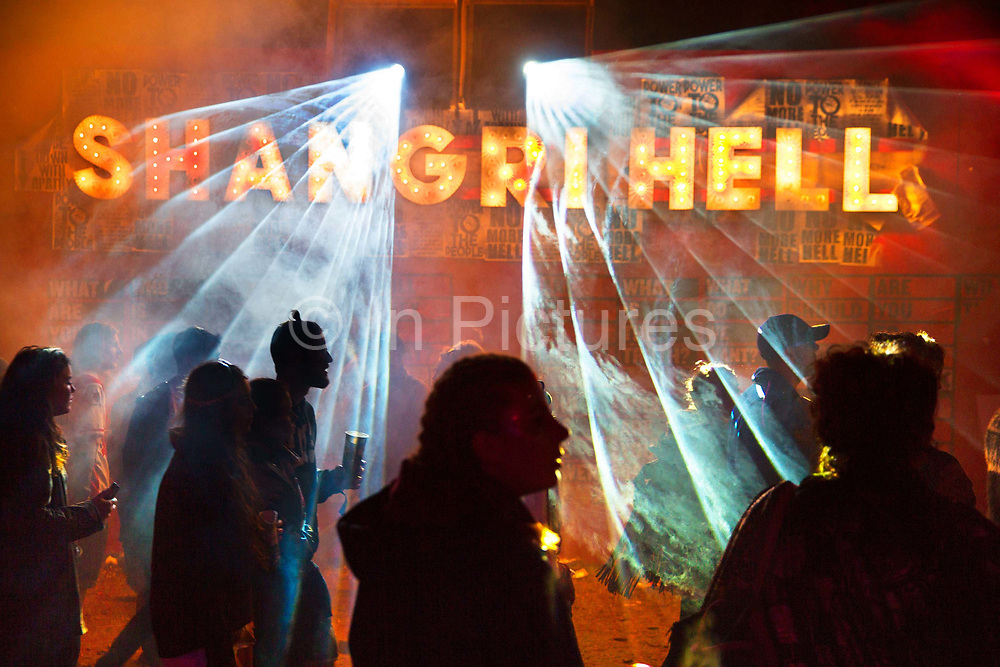 Glastonbury Festival, 2015. Shangri La is a festival of contemporary performing arts held each year within Glastonbury Festival. The theme for the 2015 Shangri La was Protest. People arriving into the Hell area of the Shangri La field.