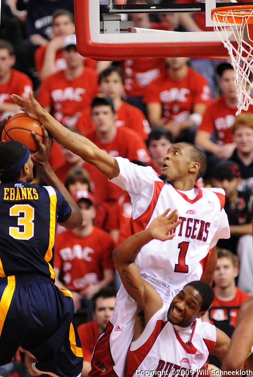 Feb 22, 2009; Piscataway, NJ, USA; Rutgers guard Corey Chandler (1) jumps over teammate Anthony Farmer (2) to block a shot attempt by West Virginia forward Devin Ebanks (3) during the second half of Rutgers' 74-56 loss to West Virginia at the Louis Brown Athletic Center.