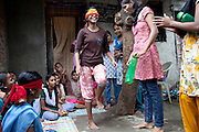 Mayuri Mahesh Pandit, 13, (centre) is participating to the Unicef-run 'Deepshikha Prerika' project inside the Milind Nagar Pipeline Area, an urban slum on the outskirts of Mumbai, Maharashtra, India, where she resides with her family. The adolescents are playing a game of trust, confidence and memory, by walking over the bottles - first seeing normally - and then using a blindfold to stimulate the other senses.