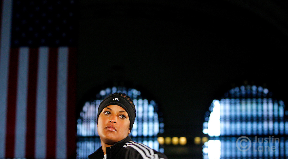 Boxer Laila Ali, daughter of legendary boxer Muhammad Ali, warms up during a public workout in Grand Central Station in New York on 07 November 2006.