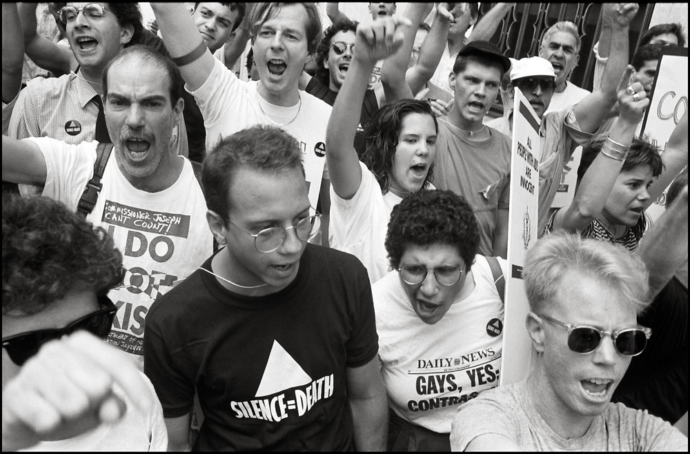 ACT UP demonstrates outside the offices of the New York City Commissioner of Health, Stephen Joseph, after he suddenly halved the number of estimated AIDS cases in NYC, on July 19th, 1988 - a move that threatened to drastically reduce funding for AIDS services.