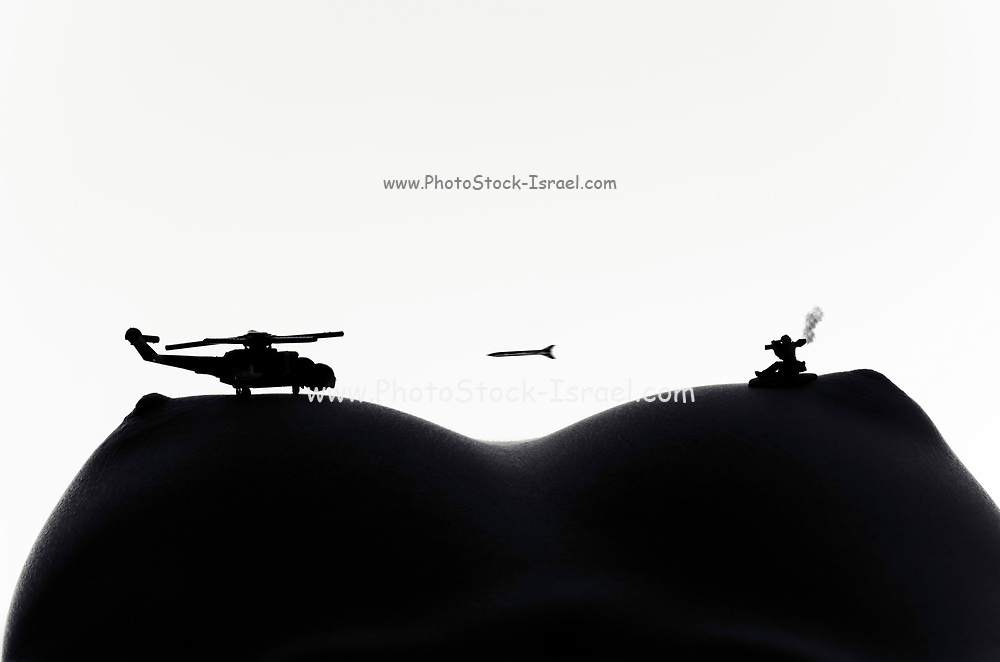 Miniature toy soldiers and aircraft battling on a woman's torso