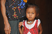 Portrait of a young girl in Laos with her mother