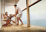 A couple has fun while hanging out on the deck of a Cruise ship at sea