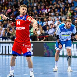 Oddur Gretarsson (HBW Balingen-Weilstetten #14) beim Spiel in der Handball Bundesliga, TVB 1898 Stuttgart - HBW Balingen-Weilstetten.<br /> <br /> Foto © PIX-Sportfotos *** Foto ist honorarpflichtig! *** Auf Anfrage in hoeherer Qualitaet/Aufloesung. Belegexemplar erbeten. Veroeffentlichung ausschliesslich fuer journalistisch-publizistische Zwecke. For editorial use only.