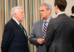United States House Minority Whip Steny Hoyer (Democrat of Maryland), left, with US House Majority Leader Kevin McCarthy (Republican of California), center, and Jared Kushner, Senior Advisor to the President, right, prior to the arrival of US President Donald Trump at a reception for US House and US Senate Republican and Democratic leaders in the State Dining Room of the White House in Washington, DC, USA, on Monday, January 23, 2017. Photo by Ron Sachs/CNP/ABACAPRESS.COM
