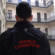 "World Champion same-sex ballroom dancer Robert Tristan Szelei stands in a courtyard outside of the apartment of his dance partner, Gergely Darabos, in Budapest, Hungary on October 21, 2006, the morning of the 2nd annual World Championship Same-Sex Ballroom Dancing competition. ..Szelei and Darabos, who are known as the ""Black Swans,"" are the reigning world champions in men?s Latin same-sex ballroom dancing. They have been training and preparing to host the 2nd annual World Championship and the Csardas Cup, the first-ever Eastern European same-sex ballroom competition, both held at the Korcsarnok arena.  This is the pinnacle event of the blossoming same-sex ballroom scene...Szelei and Darabos went on to win the men?s Standard division and finished fourth in the Latin division. ..The event was organized by the US-based World Federation of Same-Sex Dancing, which hosted the first World Championship Same-Sex championships in 2005 in Sacramento, California. The Black Swans did a large amount of the coordination and planning in Budapest, a city that had never seen an event of this kind. When government funding fell through, they secured funding from patron Desire (accent on the ?e?) Dubounet, owner of the local Club Bohemian Alibi drag club. ..The World Championship events are newly recognized, but same-sex dancers have been competing on a national and international circuit for a number of years, especially in Europe, including at the Eurogames, the Gay Games, the London Pink Jukebox Trophy and the Berlin Open, among others. Countries including the United States, the Netherlands, Germany and, now, Hungary, hold their own national same-sex championships. Hungary held its first national championships in April 2006...Szelei and Darabos spent three months at the Sacramento Dancesport same-sex dance school in California this summer, on the first scholarship offered by the World Federation. The men both got their early training as opposite sex dancers, then started dancing toge"