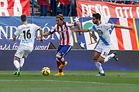 Atletico de Madrid´s Alessio Cerci (C) and Deportivo de la Coruña´s Insua during 2014-15 La Liga match between Atletico de Madrid and Deportivo de la Coruña at Vicente Calderon stadium in Madrid, Spain. November 30, 2014. (ALTERPHOTOS/Victor Blanco)