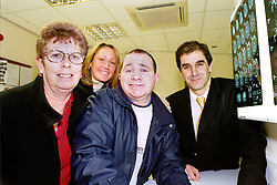 Looking at the results of some MRI brain scans are former World Champion Boxer Paul Ingle (centre)  with (from left to right) his mum Carol, Fiance Sam Coulson and Dr Robert Peck of Sheffields Royal Hallamshire Hospital on Thursday 7 Feb. where Paul officially opened the hospitals new MRI scanner