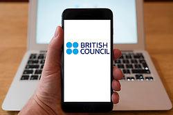 Using iPhone smartphone to display logo of the British Council