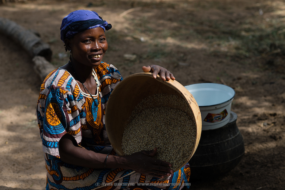 Maria Abache washing millet, a local grain staple, using water from a WaterAid pump in the village of Din-Rimi in the Zinder Region of Niger on 24 July 2013.