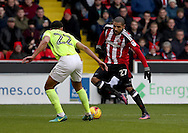 Leon Clarke Lewin of Sheffield United taking on Lewin Nyatanga of Northampton Town during the English Football League One match at Bramall Lane, Sheffield. Picture date: December 31st, 2016. Pic Jamie Tyerman/Sportimage