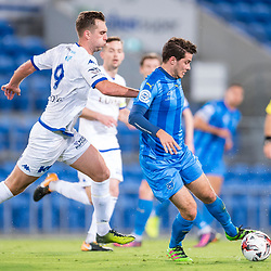 BRISBANE, AUSTRALIA - SEPTEMBER 20: Roman Hoffman of Gold Coast City controls the ball under pressure from Milos Lujic of South Melbourne during the Westfield FFA Cup Quarter Final match between Gold Coast City and South Melbourne on September 20, 2017 in Brisbane, Australia. (Photo by Gold Coast City FC / Patrick Kearney)