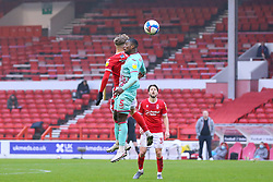 Marc Guehi of Swansea City and Will Swan of Nottingham Forest compete in the air - Mandatory by-line: Nick Browning/JMP - 29/11/2020 - FOOTBALL - The City Ground - Nottingham, England - Nottingham Forest v Swansea City - Sky Bet Championship