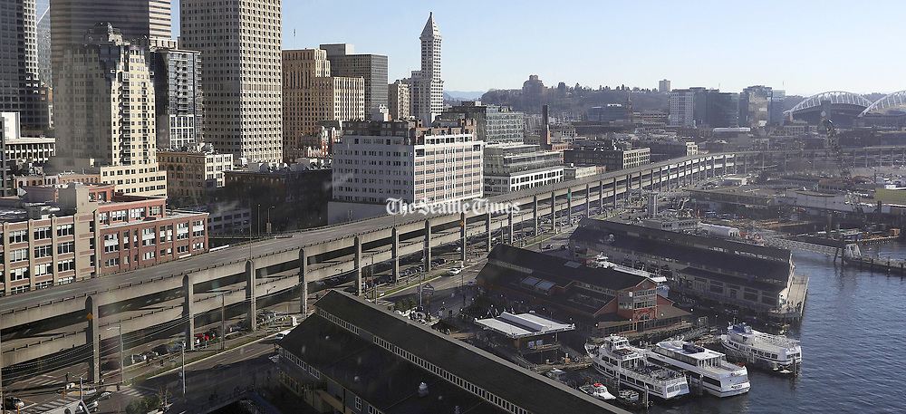 A view of the permanently closed Viaduct, with Smith Tower in the background, is seen from the Seattle Great Wheel, Sunday, Jan. 13, 2019, about 18 hours before the city will be tested with its first morning rush hour without the highway. (Ken Lambert / The Seattle Times)