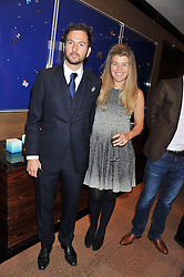 CHRIS GORELL BARNES co-founder of the Blue Marine Foundation and AMBER NUTTALL at a lunch to announce the partnership between Creme de la Mer and BLUE Marine Foundation held at Sotheby's 34-35 New Bond Street, London on 18th May 2012.