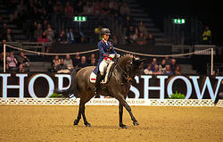 Great Britain's Charlotte Dujardin riding Hawtins Delicato competes in the FEI Dressage World Cup Grand Prix during day one of the London International Horse Show at London Olympia.