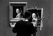 Artist painting a reproduction of a Vermeer